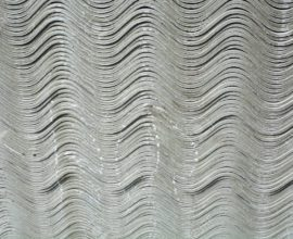 New asbestos boards in stock. Asbestos sheets are exposed for sale